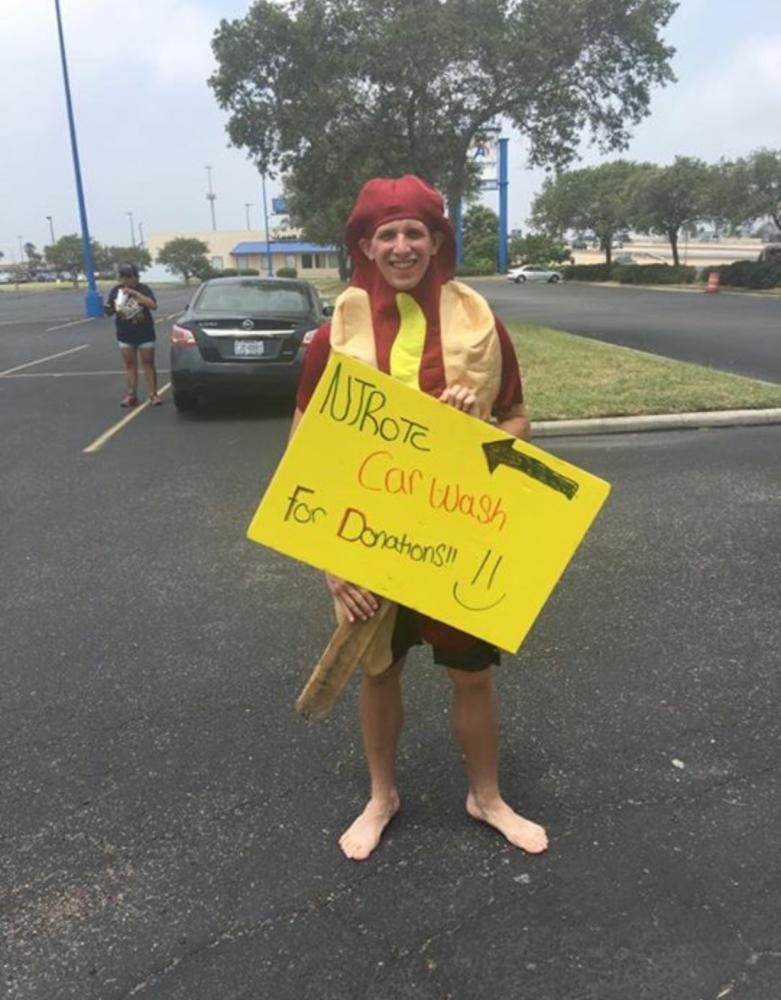 Senior+William+O%27Connor%2C+dressed+in+a+hotdog+suit%2C+holds+a+sign+to+encourage+passersby+to+get+a+car+wash+on+April+29+near+Joe%27s+Crab+Shack.+The+donations+went+to+the+ROTC+program.