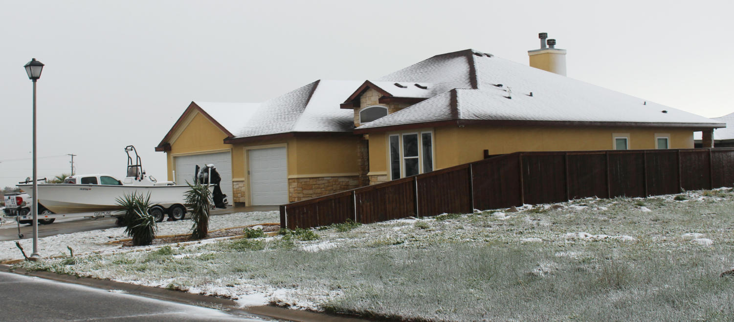 Snow blankets a house in Padre Island on Dec. 8.