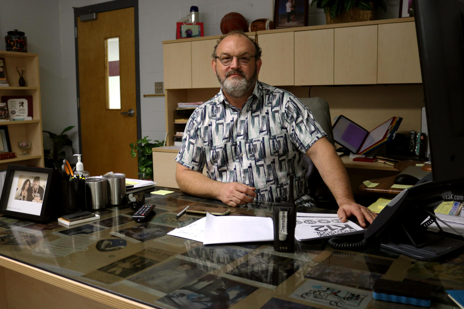 Principal James Crenshaw sits at his office desk on Feb. 21. Beginning in the first grade, he spent three years in a wheelchair due to a leg condition.
