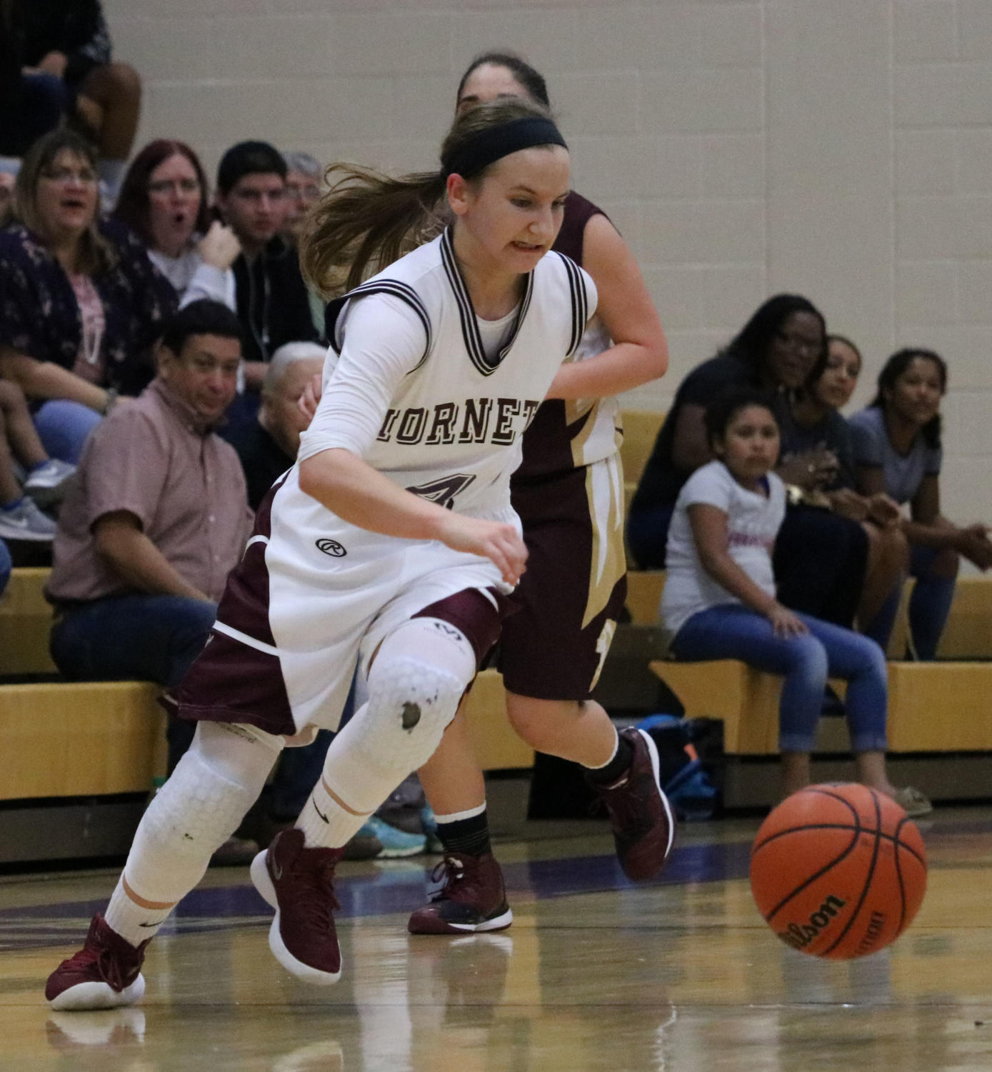 Senior Meredith Marcum brings the ball up the court against Tuloso- Midway on Feb. 20 in the  third round of the playoffs. The Hornets won, 58-33.