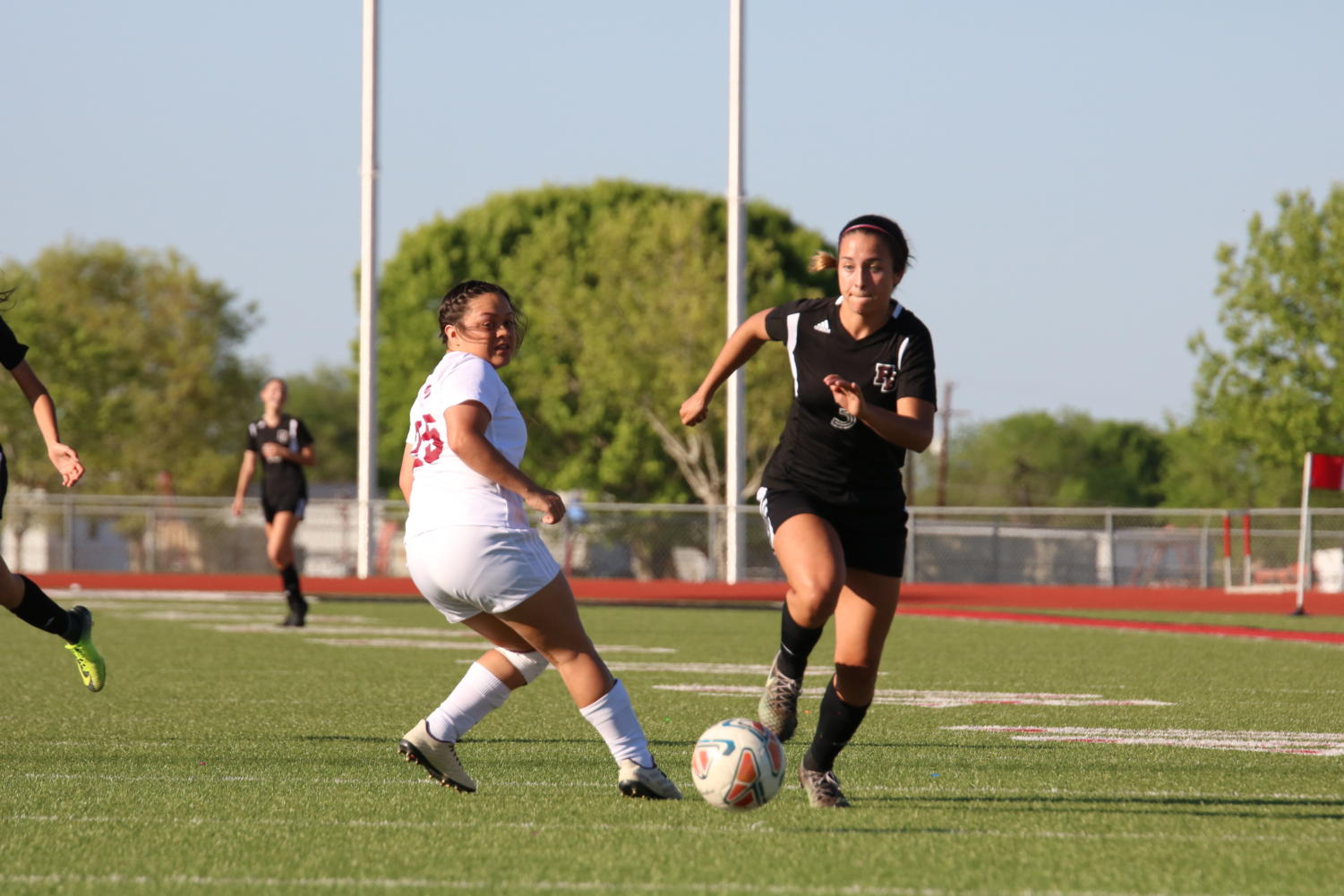 Junior Liv Cerna gets past a defender in a game against Uvalde on March 29. Flour Bluff won 1-0.