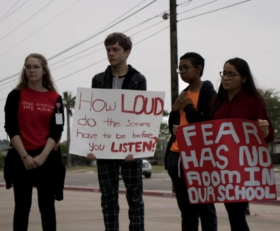Juniors+Azure+Spofford%2C+Asher+Whitmire%2C+sophomore+Jack+Bolden%2C+and+senior+Becca+Molina+stand+holding+signs+in+protest+of+gun+violence+on+April+20.