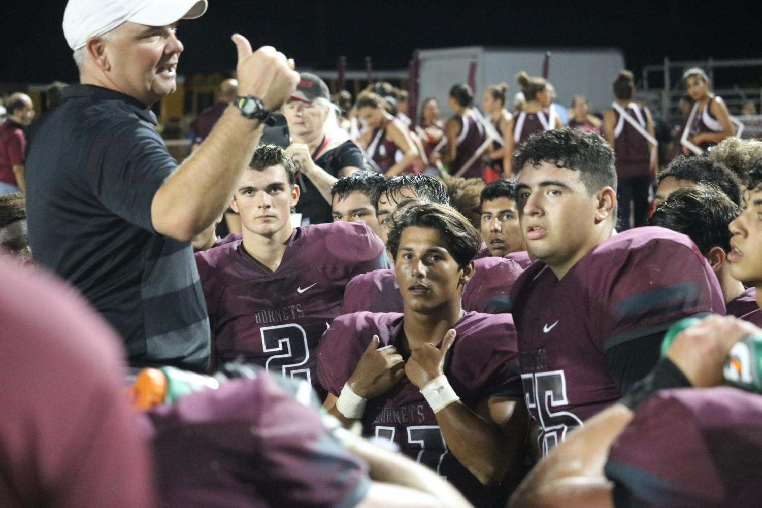 Coach Steinbruck speaks to his players following their 33-38 win against PSJA