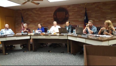 The school board prepares for the meeting held on July 26. Members (from left to right) : Jeff Rank, Jim Needham, Shirley Thornton, Steve Ellis, Michael Morgan, Brian Grunberg and Jennifer Welp.