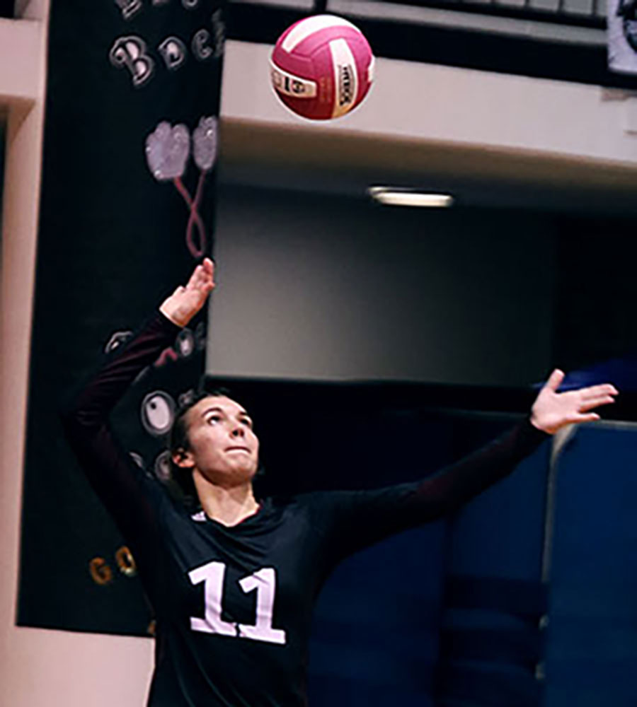 Sophomore Mackenzie Wiggins serves the volleyball in the game against Tuloso-Midway on Oct. 15. The Hornets won 3-0.