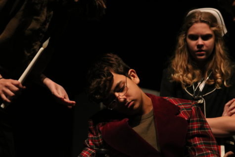 "Having just been murdered, freshman Landon Alaniz, playing Simon Starkweather, shocks sophomore Beau Borgmeyer, portraying Miss Withers, during the dress rehearsal for the play ""Murder"