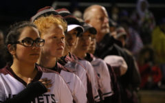 Standing at attention for the National Anthem, senior Alyx Salinas and freshman Harley Elam prepare for the game against Gregory-Portland on March 5. The Lady Hornets won 8-3.