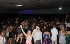 Students in the Hornet Ballroom enjoy dancing with friends at the homecoming dance.