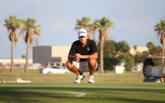 Jaymim DeLafuente, senior , studying his plan of attack for putting.